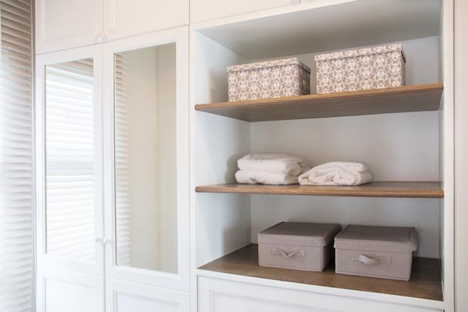 decluttering the bedroom, mirrors on cupboard doors and shelves