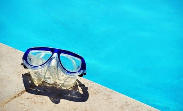 goggles next to a pool