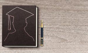 graduation journal and pen