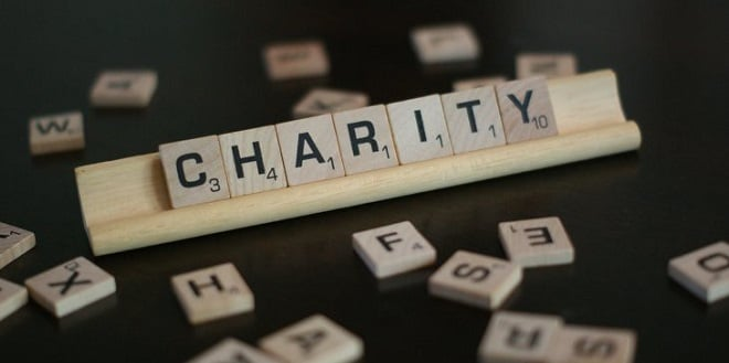 scrabble letters spelling out charity
