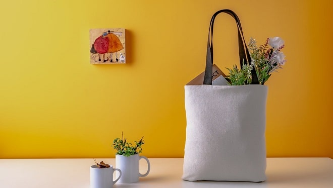 mall groceries on a white table with a yellow wall in the background, pictire on the wall