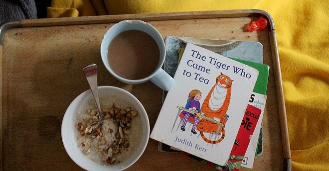 the tiger who came to tea book alongside a cup if tea on a tray