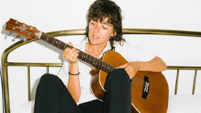 Courtney Barnett playing the guitar