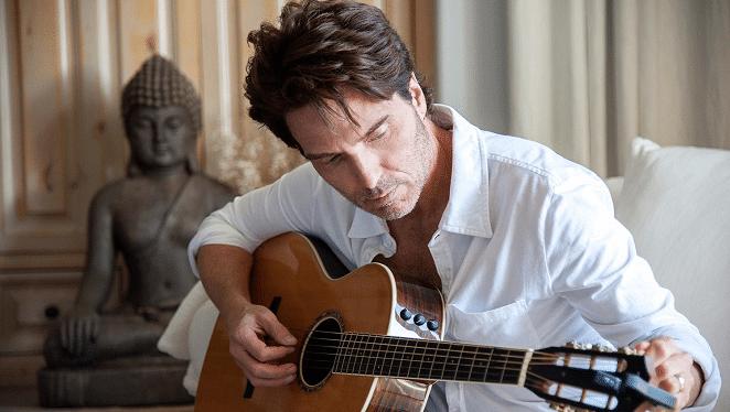 Richard Marx playing his guitar