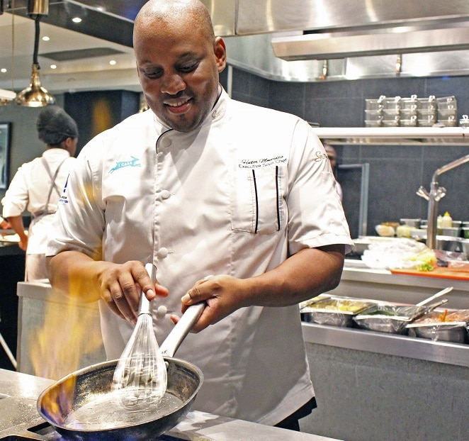 The Maslow Sandtons Executive Chef, Hector Mnyayiza, cooking in the Lacuna Bistro kitchen