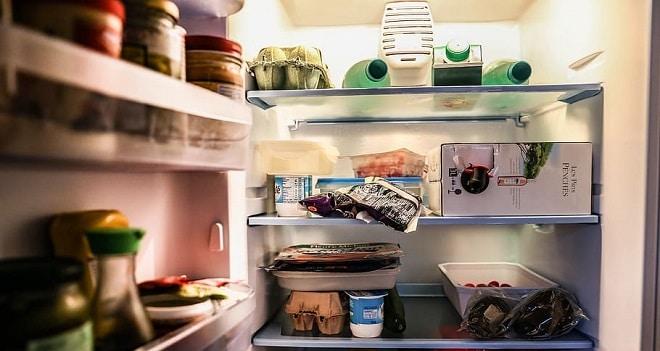 clean fridge door open with food inside