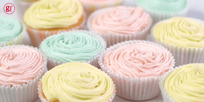 cupcakes with pastel yellow, pink and blue icing