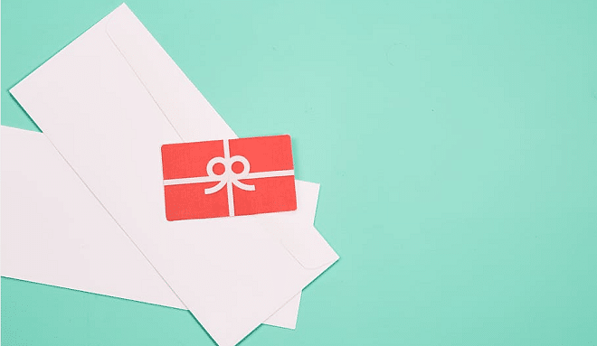 red gift card with white envelopes behind it and a blue background