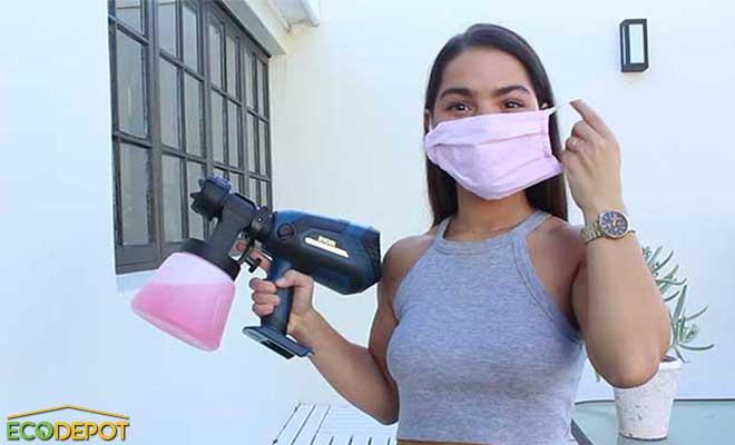 ecodepot woman holding a spray gun wearing a mask