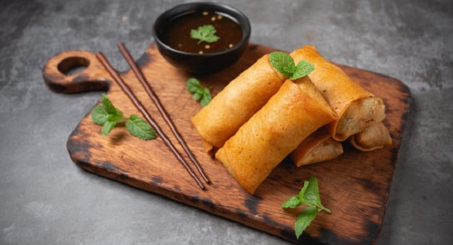 fried-spring-rolls-cutting-board