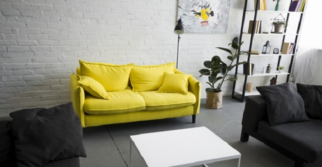 living room with yellow couch