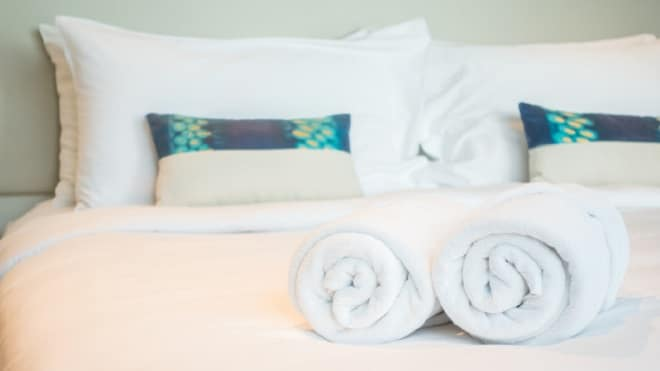 white-towel-bed-lifeforstock