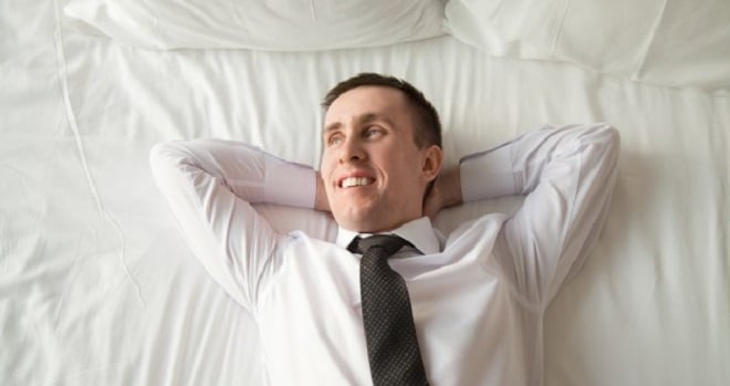 young-businessman-relaxing-bed