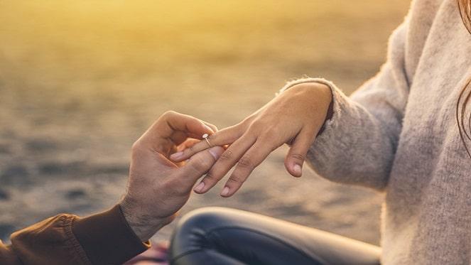 young-man-putting-wedding-ring-woman-finger_23-2148020111- freepik